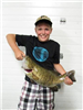 Boy showing a caught smallmouth bass